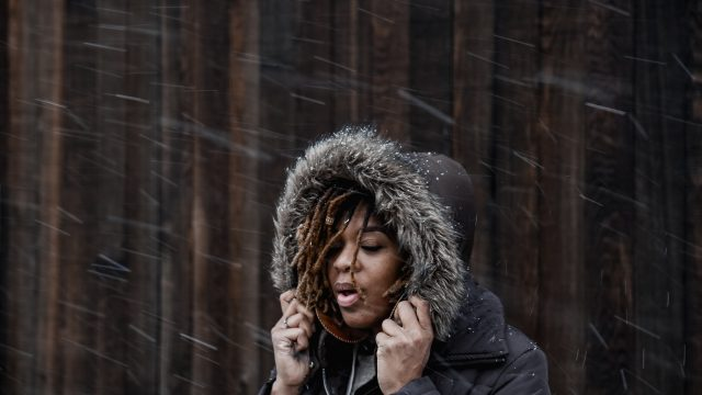 Woman Outside in Light Snow Blizzard
